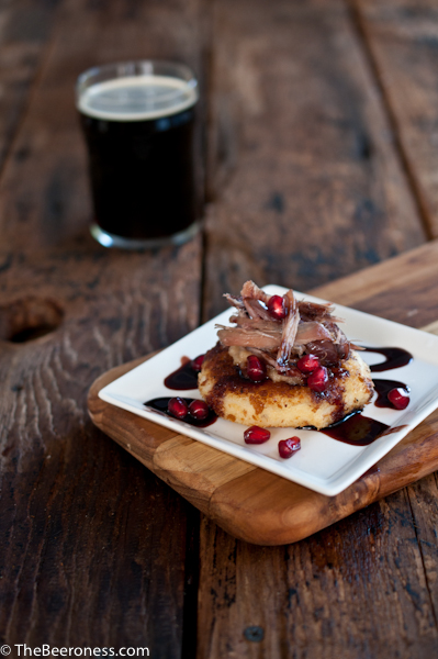 Duck Confit on IPA Potato Cakes with Stout Pomegranate Sauce