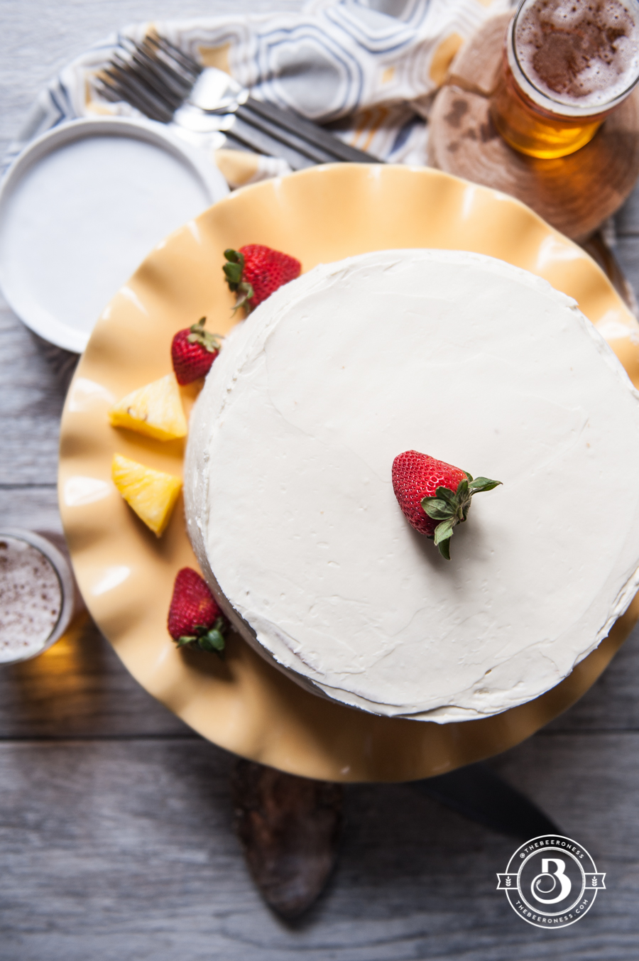 Strawberry Pineapple Pale Ale Cake with Whipped Cream Cheese Frosting. So moist and delicious with my FAVORITE frosting ever.