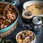 Stout Creole Gumbo over Smokey Cheddar Grits