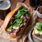 Black Pepper Flank Steak Sandwich with Brie and Beer Caramelized Onion Jam