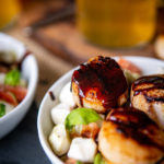 Beer Brined Balsamic Glazed Scallops over Avocado Caprese Salad