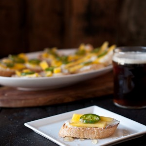 Goat Cheese Crostini with Beer Pickled Jalapenos and Mangos