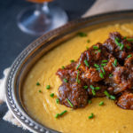 Sriracha Stout Braised Beef Shanks over Gouda Polenta