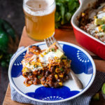 Black Bean and Grilled Poblano Elote Enchiladas with Chipotle Stout Red Sauce